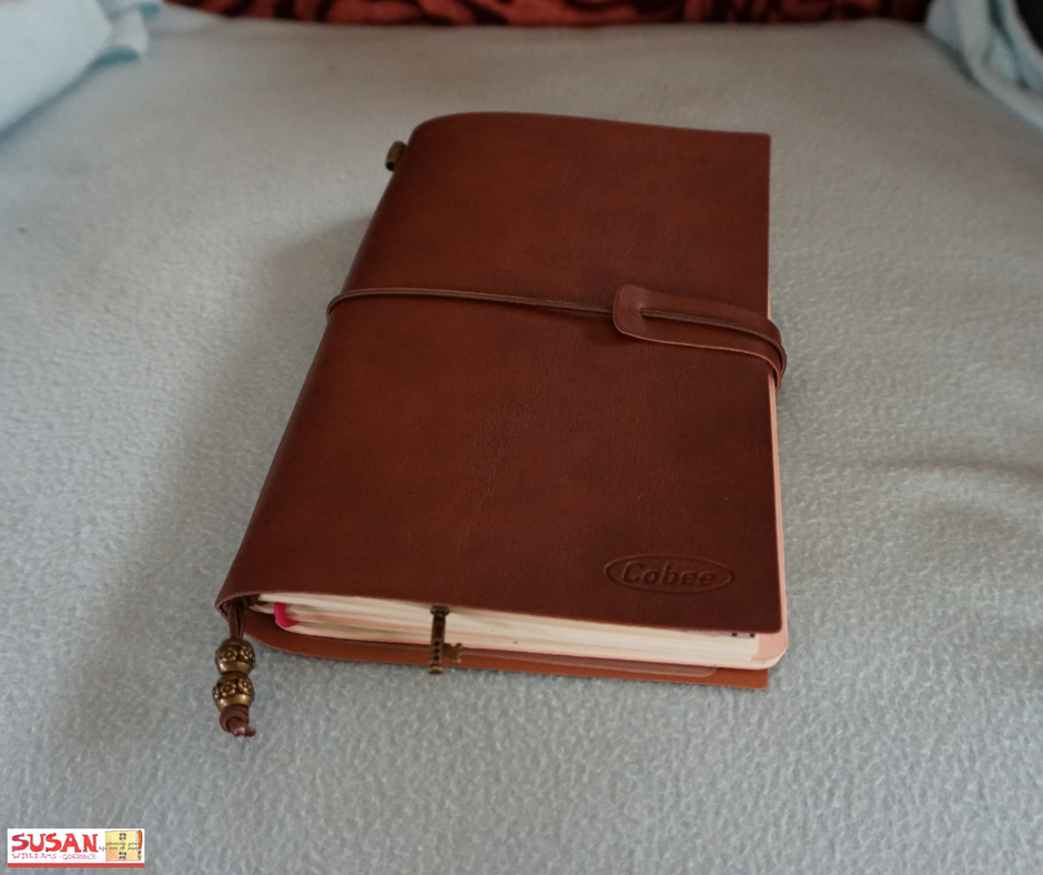 Travellers note book which holds my Personal Growth Workbooks